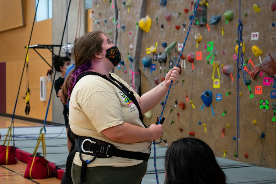 Volunteer Aurora Brinkman belays climbers at the Courageous Kids Climbing event, Sunday, Sept. 26, 2021, in Pullman, WA.