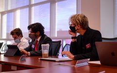 All-Campus Senator Nikolai Sublett listens to a resolution that would require senators to work on one resolution or two bylaws during an ASWSU meeting Wednesday evening in the Compton Union Building.