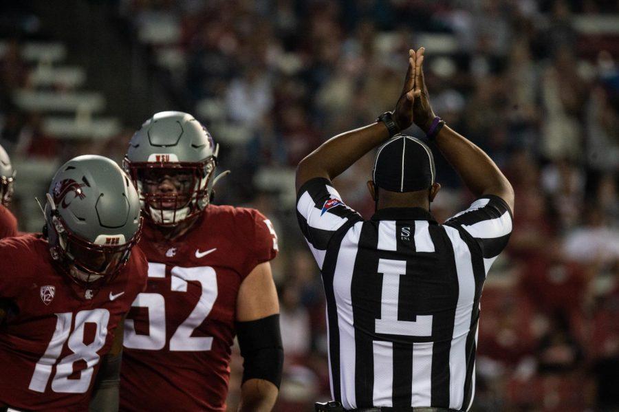 Utah States defense scores a safety after sacking WSU quarterback Jarrett Guarantano in the endzone at Martin Stadium in Pullman, Wash., Saturday, Sept. 4, 2021.