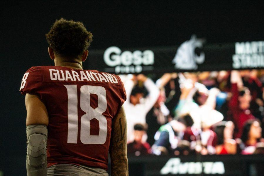 Washington State University quarterback Jarrett Guarantano prepares to welcome his team into the locker room after the first half at Martin Stadium in Pullman, Wash., Saturday, Sept. 4, 2021.