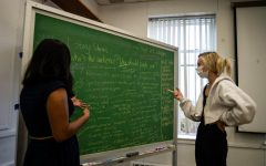 Editor-in-chief Loren Negron (left) and Managing Editor Sandi Kobiesa (right) plan for next week's edition.