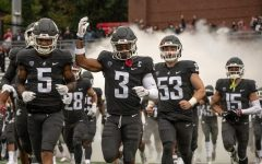 WSU defensive back Daniel Isom (3) leads his team onto the field before a game against USC Sept. 18 in Pullman.