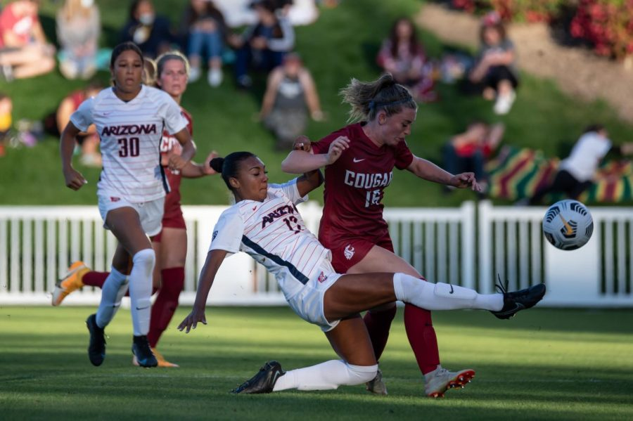 WSU forward Alyssa Gray battles Arizona defender Mariah Dunn for the ball during the first half of a match Sept. 24, 2021, in Pullman.