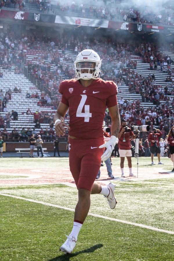 Washington State University quarterback Jayden De Laura rushes onto Martin Stadium in Pullman, Wash. on Sept. 11, 2021.