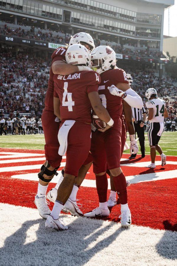 Washington State University quarterback Jayden de Laura celebrates with his teammates after his rushing touchdown in Martin Stadium on Sept. 11, 2021.