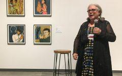 Alison Saar walks patrons of the museum through her exhibit Mirror, Mirror.