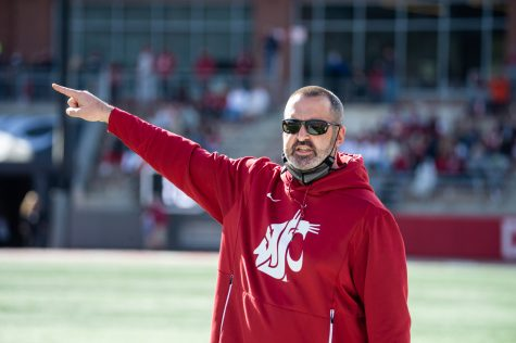 Nick Rolovich talks with a referee during a football game at Martin Stadium Oct. 9 in Pullman.