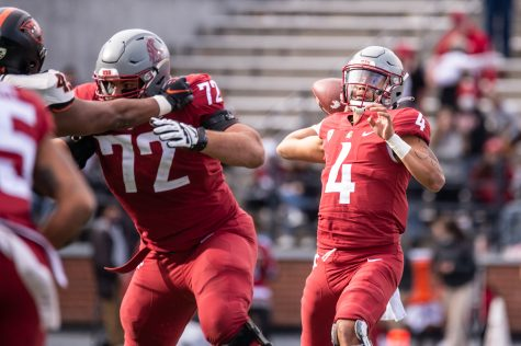 WSU quarterback Jayden de Laura (4) throws the ball downfield during a college football game Oct. 9 at Martin Stadium in Pullman.