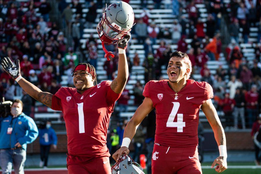 WSU wide reciever Travell Harris (1) and quarterback Jayden de Laura (4) celebrate after winning a college football game at Martin Stadium, Saturday, Oct. 9, 2021, in Pullman, Wash.