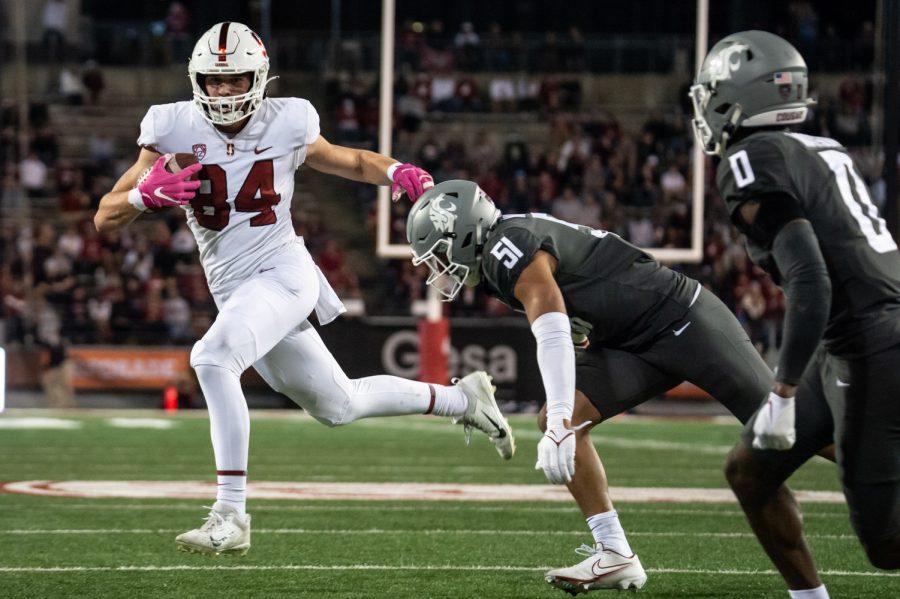 Stanford University tight end Benjamin Yurosek (84) evades Washington State University linebacker Francisco Mauigoa (51) during the second half of a college football game at Martin Stadium, Saturday, Oct. 16, 2021, in Pullman, Wash.