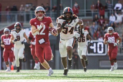 WSU wide reciever Joey Hobert (12) runs toward the endzone during a college football game Saturday at Martin Stadium.