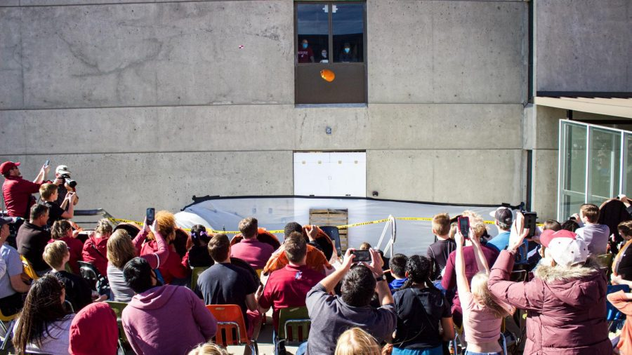 Spectators watch as 13 pumpkins are dropped on Oct. 16 from the twelfth floor of the Webster Physical Science Building.