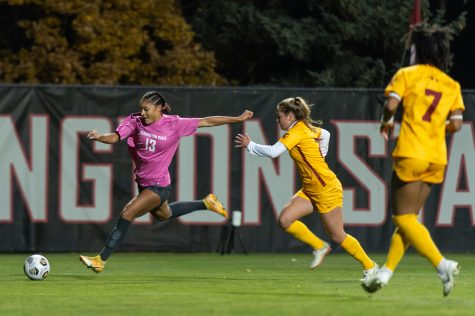 WSU forward Elyse Bennett (13) shoots on goal during a college soccer match against USC on Oct. 21, 2021, in Pullman.